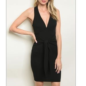 Black Sleeveless V-neck belted bodycon dress.